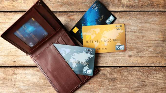Wallet with Credit Cards from Adobe Stock: Charge Card vs Prepaid Credit Card vs Secured  Credit Card
