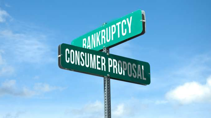sign represents decision to be made: consumer proposal or bankruptcy