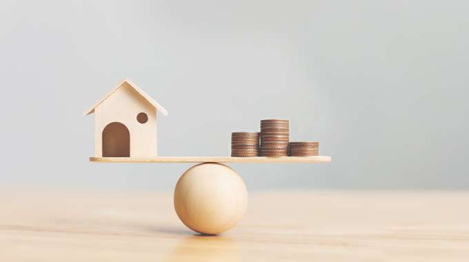 seesaw balancing home equity loans and mortgage refinancing
